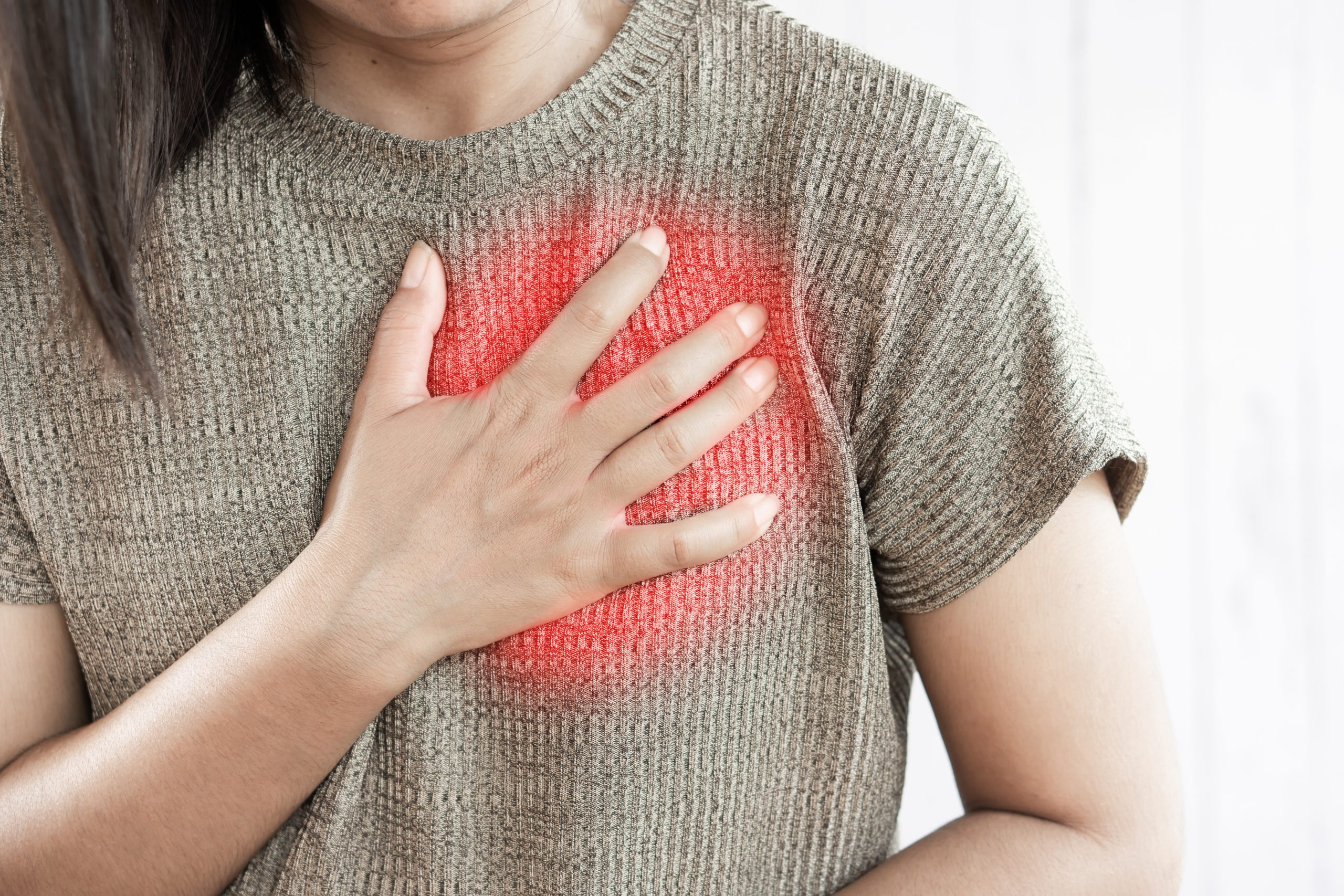 woman with chest pain feeling pressure